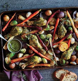 Sheet of roasted vegetables and chicken thighs with pesto