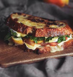 brie, pear, prosciutto and arugula grilled cheese sandwich